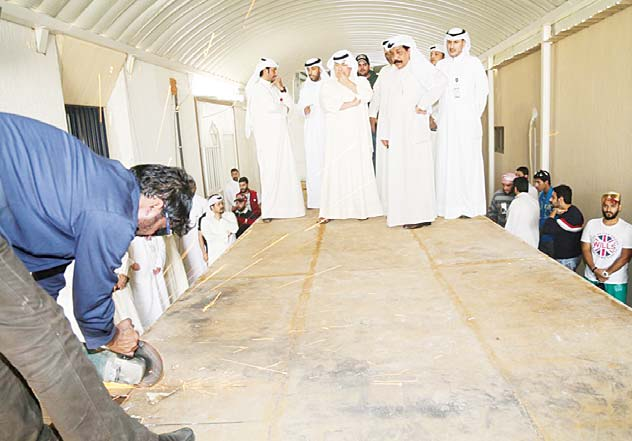 Lt-Gen Sulaiman Al-Fahad, Major General Abdulhameed Al-Awadhi and other senior officials look on as Customs men open up the container packed with hashish and drug pills.