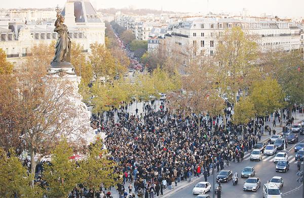 People gather around the Monument a la Republique at the Place de la Republique in Paris,