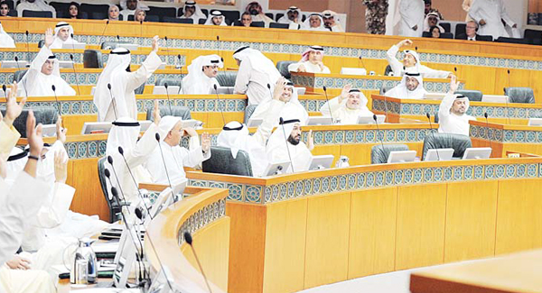 National Assembly members raise up their hands to catch the Speaker's eye in Tuesday's Assembly session