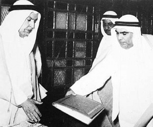 Sheikh Abdullah Al-Salem Al-Sabah receiving a copy of Kuwaiti Constitution from the head of Foundation Council Abdullatif Mohammad Alghanim