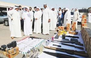 Securitymen and CID officials inspecting the seized weapons in the farm.