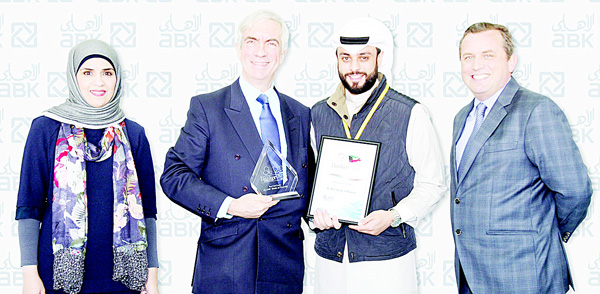 Sawsan Ali & Faisal Al-Tamimi (ABK), receiving 'Best Call Center' Award from Banker ME in the presence of Stewart Lockie, GM Retail Banking.