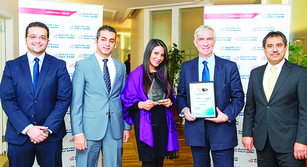 Robin Amlot, CEO at CPI Financial, presenting the 'Best Cash Management' award to members of Gulf Bank's Cash Management team.