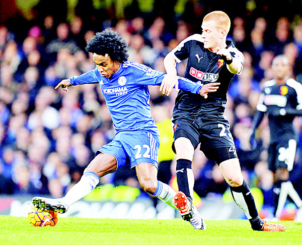 Chelsea's Brazilian midfielder Willian (left), vies with Watford's English midfielder Ben Watson (right), during the English Premier League football match between Chelsea and Watford at Stamford Bridge in London on Dec 26. (AFP)