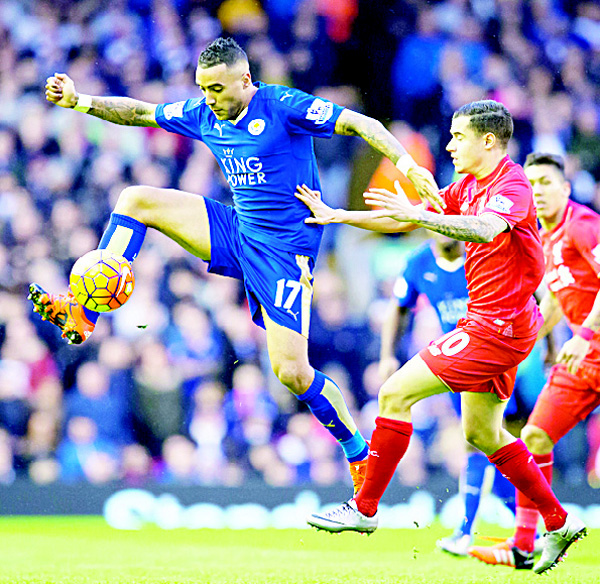 Leicester City's Danny Simpson (left), fights for the ball against Liverpool's Philippe Coutinho during the English Premier League soccer match between Liverpool and Leicester City at Anfield Stadium, Liverpool, England on Dec 26. (AP)