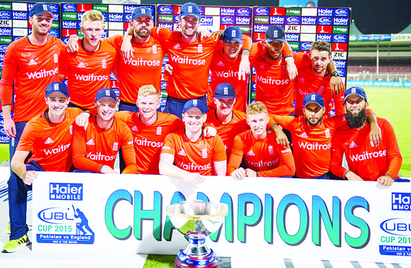 England's players celebrate their victory of the series at the end of the third T20 cricket match between Pakistan and England at the Sharjah Cricket Stadium in the United Arab Emirates of Sharjah on Nov 30. (AFP)