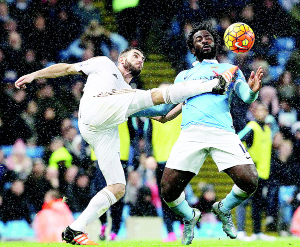 Swansea City's Spanish defender Angel Rangel (left), vies with Manchester City's Ivorian striker Wilfried Bony (right), during the English Premier League football match between Manchester City and Swansea City at the Etihad Stadium in Manchester, north west England, on Dec 12. (AFP)