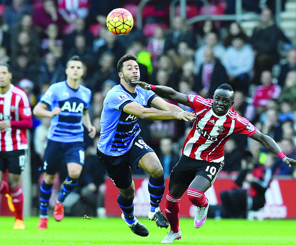 Tottenham Hotspur's Belgian midfielder Mousa Dembele (third left), vies with Southampton's Senegalese midfielder Sadio Mane (right), during the English Premier League football match between Southampton and Tottenham Hotspur at St Mary's Stadium in Southampton, southern England on Dec 19. (AFP)