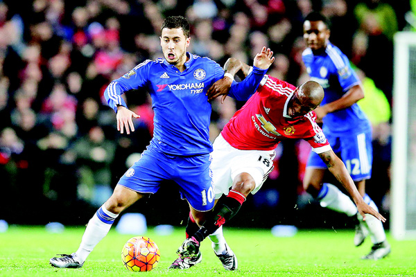 Chelsea's Eden Hazard (left), is challenged by Manchester United's Ashley Young during the English Premier League soccer match between Manchester United and Chelsea at Old Trafford Stadium, Manchester, England on Dec 28. (AP)