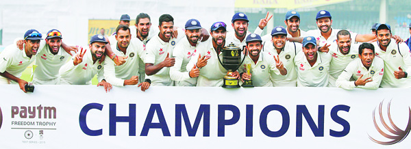 Indian Test cricket team members pose with the Freedom Trophy after India won their third Test match against South Africa on the fifth day of the fourth Test match in New Delhi, India, on Dec 7. India won the Test series 3-0 after the second Test match was drawn. (AP)