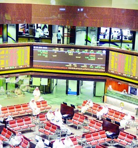 Traders watch share movements at the Kuwait Stock Exchange.