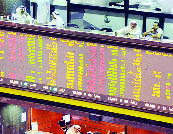 Electronic board shows share movements at the Kuwait Stock Exchange.