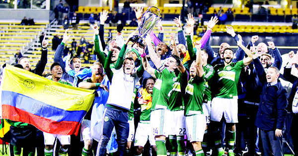 Portland Timbers raise the trophy after defeating the Columbus Crew 2-1 in the MLS Cup championship soccer game, Dec 6, in Columbus, Ohio. (AP)