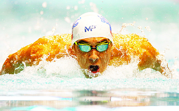 Michael Phelps swims in the 200 meter Individual Medley during the AT&T Winter National Championships at the Weyerhaeuser King County Aquatic Center on Dec 3, in Federal Way, Washington. (AFP)