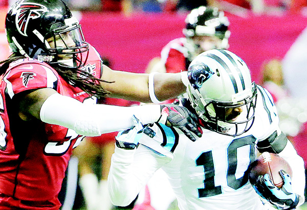 Atlanta Falcons strong safety Kemal Ishmael (36) tackles Carolina Panthers wide receiver Corey Brown (10) during the first half of an NFL football game, on Dec 27, in Atlanta. (AP)