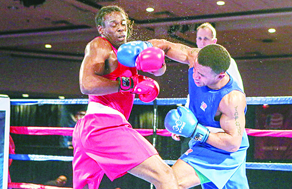 In this photo taken on Dec 9, Derae Crane and Cam Awesome (left), compete in the US Olympic Boxing Trials in Reno, Nev. (AP)