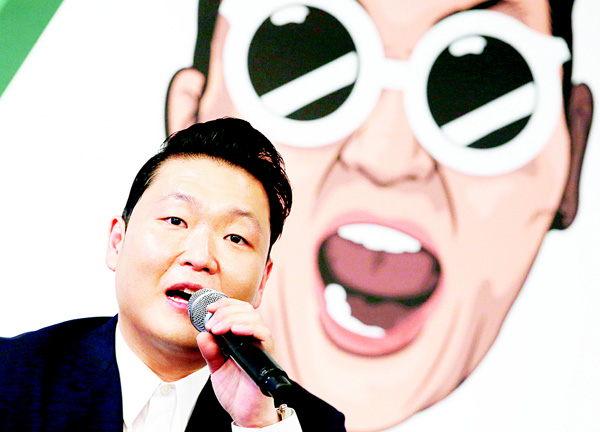 South Korean singer PSY answers a reporter's question during a news conference on the release of his seventh album in Seoul, South Korea on Nov 30. (AP)