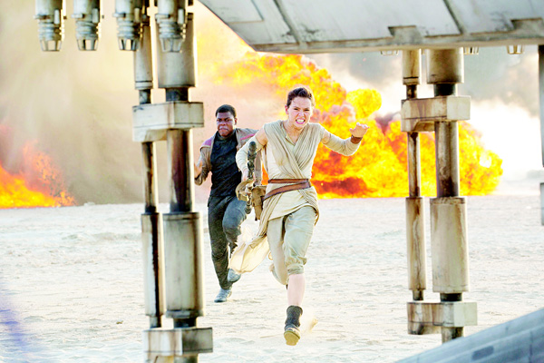 This photo provided by Disney/Lucasfi lm shows Daisy Ridley (right), as Rey, and John Boyega as Finn, in a scene from the fi lm, 'Star Wars: The Force Awakens', directed by J.J. Abrams. (AP)