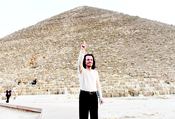 This Oct 28, 2015 file photo shows Greek-American contemporary composer Yiannis Chryssomallis, who goes by the stage name Yanni, posing for a picture during a visit to the Giza Pyramids south of the Egyptian capital Cairo. (AFP)