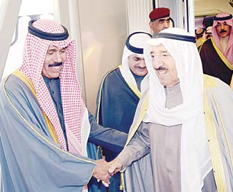 His Highness the Amir Sheikh Sabah Al-Ahmad Al-Jaber Al-Sabah being greeted by His Highness the Crown Prince Sheikh Nawaf Al- Ahmad Al-Jaber Al-Sabah upon arrival