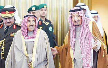 Saudi King Salman bin Abdulaziz (right), welcomes Amir of Kuwait, Sheikh Sabah Al-Ahmad Al-Sabah upon the latter's arrival to attend the 136th Gulf Cooperation Council (GCC) summit, in the Saudi capital Riyadh,