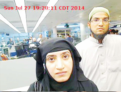 This July 27, 2014 photo provided by US Customs and Border Protection shows Tashfeen Malik (left), and Syed Farook, as they passed through O'Hare International Airport in Chicago