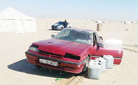 One of the sports cars used by drifters found in a livestock pen in Wafra.