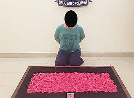 The man with the seized narcotic pills