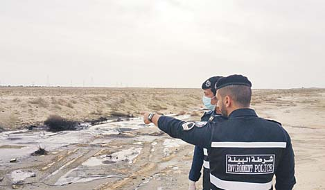 Environment police take stock of the waste material dumped in the vicinity of Kuwait Airport.