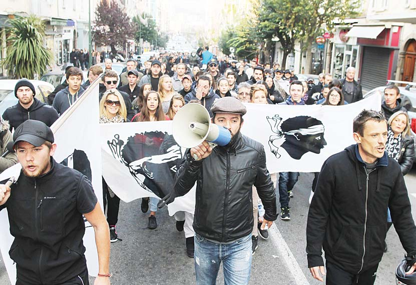 People take part in a demonstration in Ajaccio on Dec 27. (AFP)