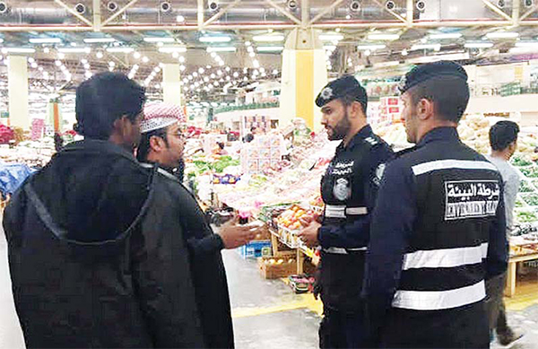 Environment policemen taking a round in the Sulaibiya vegetable market.