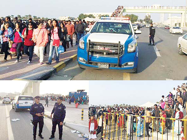 (Top and above): Traffice police and securitymen surround the area as church-goers take to the road on Christmas Day. Minister of Interior Sheikh Mohammad Al-Khaled Al-Sabah toured Christian places of worship to get firsthand information on security measures