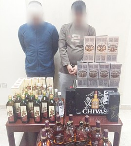 The 2 Bedouns with the seized foreign liquor bottles