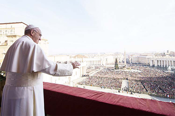 This handout picture released by the Vatican press office shows Pope Francis standing on a Balcony of St Peter's Basilica during the traditional 'Urbi et Orbi' Christmas message to the city and the world on Dec 25 in Vatican. (AFP)