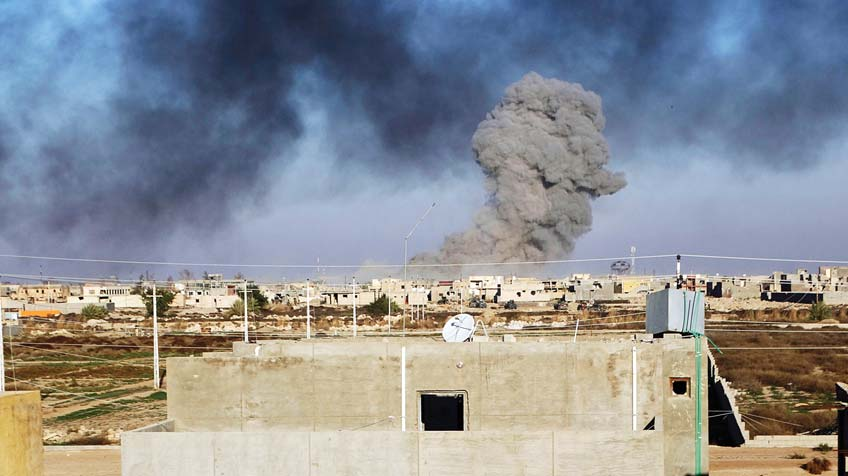 In this Dec 25 photo, smoke rises from Islamic State positions following a US-led coalition airstrike as Iraqi Security forces advance their position in downtown Ramadi, 70 miles (115 kilometers) west of Baghdad, Iraq. Iraqi forces entered the Huz at dawn, an area housing a government compound in the center of Ramadi, part of a major offensive aimed at dislodging the Islamic State terrorist militia from the western city, an Iraqi offi cial said. (AP)