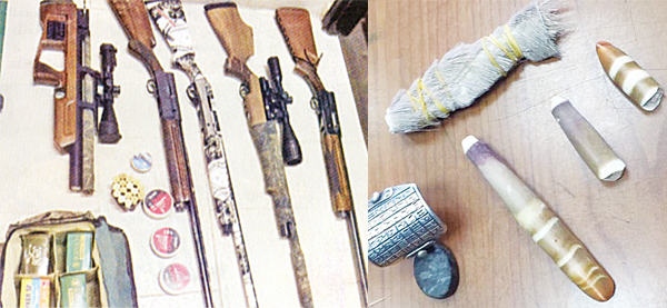 The seized hunting guns and The sorcery tools seized from the Iraqi.