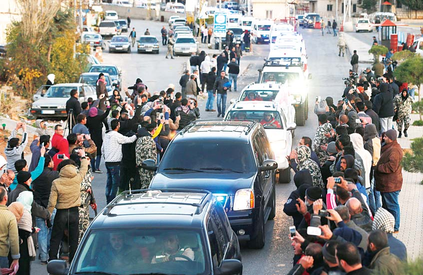 Convoys carrying wounded Syrian opposition fighters leave the Lebanese border crossing point of Masnaa on Dec 28. Syrian opposition fighters, some on wheelchairs, stretchers or crutches left the Syrian mountain resort of Zabadani toward the Lebanon border, where they will be flown to Turkey