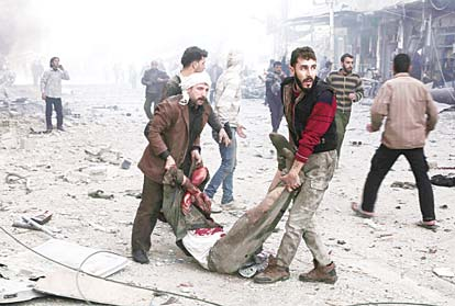 Syrian men carry a victim following reported air strikes by government forces in the town of Jisreen in the rebel-held region of Eastern Ghouta, on the outskirts of the capital Damascus, on Dec 4. At least 35 civilians were killed and dozens wounded in a series of Syrian regime raids on the rebel stronghold east of Damascus, the Syrian Observatory for Human Rights said. (AFP)