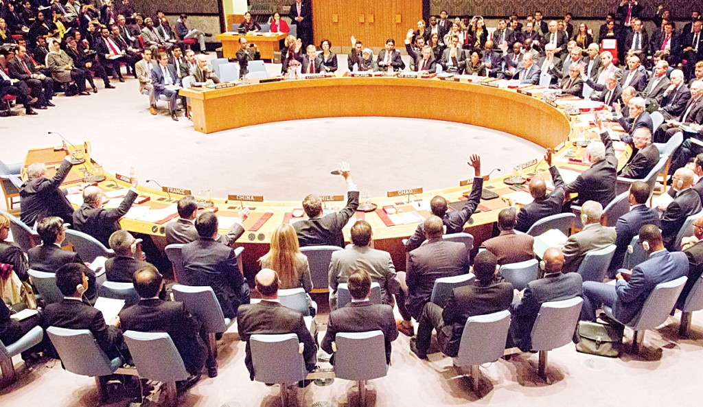 A gathering in the UN Security Council of foreign ministers led by US Secretary of State John Kerry vote on a draft resolution concerning Syria on Dec 18, at UN headquarters.