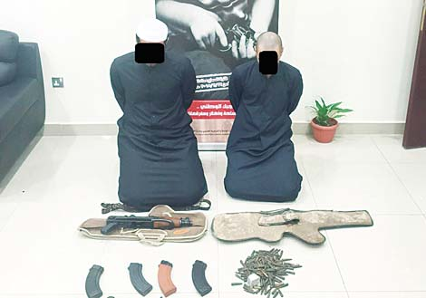 The two Kuwaitis and weapons found in their possession.
