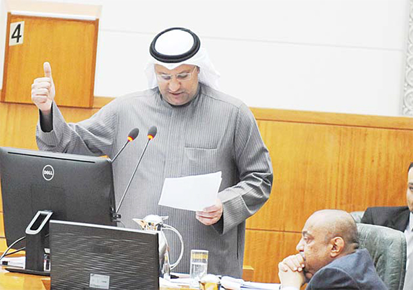 Kuwait's Health Minister Dr Ali Al-Obaidi responds to a grilling motion against him during Tuesday's Parliament session