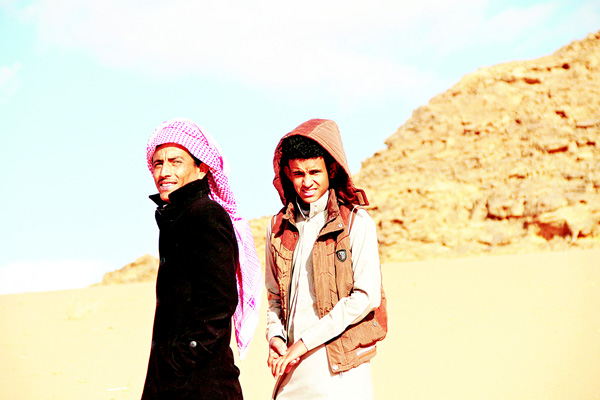 In this Jan 9, 2016 file photo, Jacir Eid Al-Hwietat (right), and his cousin, Hussein Salameh al-Sweilhiyeen, pose for a photo in Wadi Rum, a scenic desert area of southern Jordan. (AP)