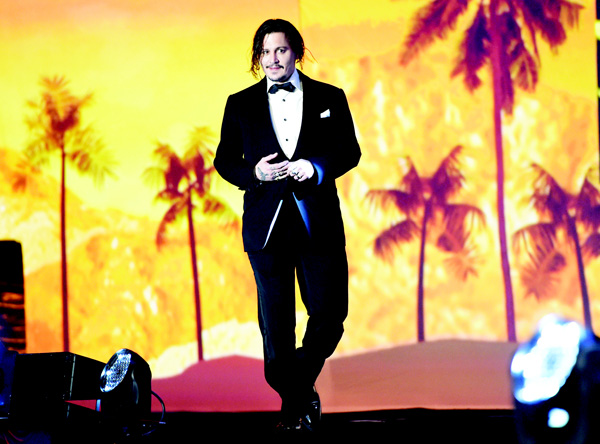Johnny Depp walks on stage to accept the Desert Palm achievement award — actor for 'Black Mass' at the 27th annual Palm Springs International Film Festival Awards Gala on Jan 2, in Palm Springs, California.