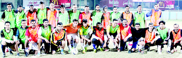 Super exhibition match teams Vet Superstars and Salmiya Stars pose for a photograph.