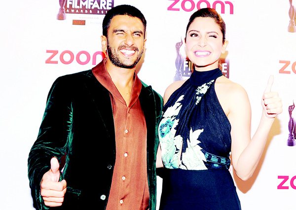 Indian Bollywood actors Ranveer Singh (left), and Anushka Sharma pose for a photograph during the Filmfare Awards 2016 party in Mumbai on late Jan 9. (AFP)