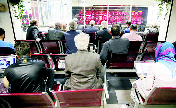 In this April 5, 2015 file photo, Iranian shareholders monitor shares prices on a display board at the Tehran Stock Exchange in Tehran, Iran. Iran said on Jan 19, it successfully transferred some of the billions of dollars' worth of frozen overseas assets following the implementation of the nuclear deal with world powers. But ordinary Iranians are still waiting to see how their daily lives will improve and how fast Iranian companies will gain access to financial markets worldwide. (AP)