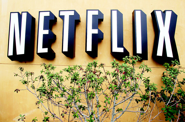 In this file photo, the Netflix logo is displayed at the company's headquarters in Los Gatos, Calif. Netflix has enjoyed top billing before: it was the biggest gainer in the S&P 500 in 2010 and 2013, and more than tripled in value both years. But another big year in 2015 pushed the company's value past established media rivals like CBS and made it about the same size as Time Warner. (AP)