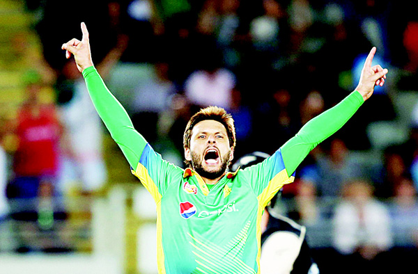 Shahid Afridi of Pakistan celebrates the wicket of New Zealand's Luke Ronchi during the second 20/20 cricket match between New Zealand and Pakistan at Eden Park in Auckland on Jan 15. (AFP)