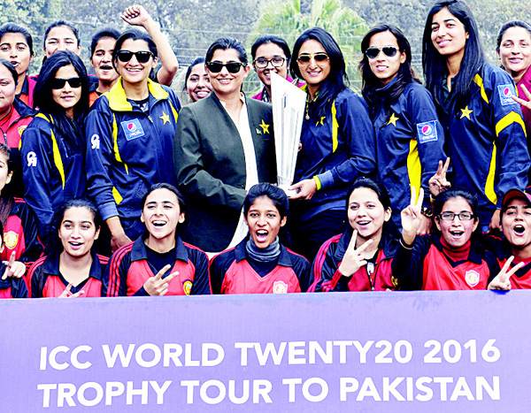 Pakistani women cricketers pose for a photograph with the ICC 2016 World Cup Twenty20 trophy during a ceremony in Lahore on Jan 12. (AFP)