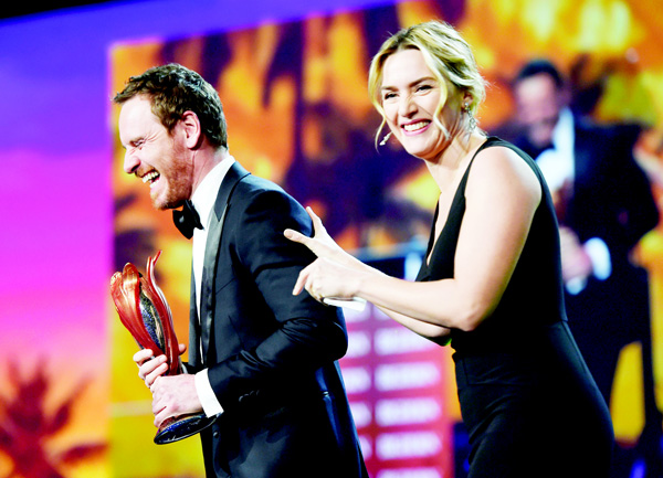 Kate Winslet (right), presents the International Star Award — actor to Michael Fassbender at the 27th annual Palm Springs International Film Festival Awards Gala on Jan 2, in Palm Springs, Calif. (AP)